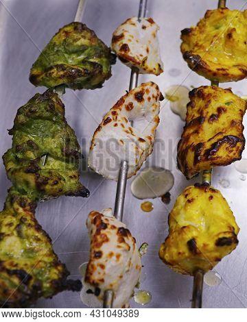 Marinated Assorted Tandoori Chicken Tikka Skewer, Includes Malai, Hariyali And Saffron Kebab