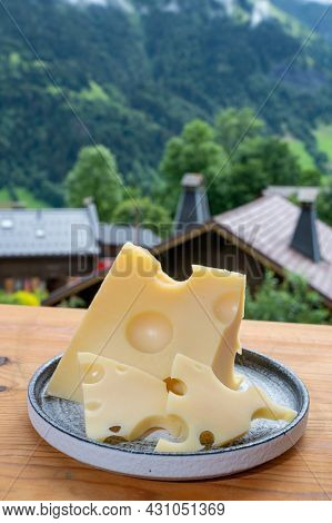 Cheese Collection, French Cow Cheese Emmental And French Mountains Village In Haute-savoie On Backgr