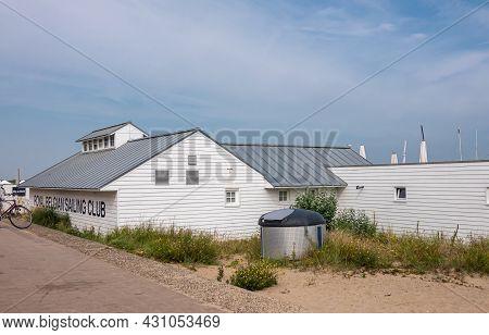 Knokke-heist, Flanders, Belgium - August 5, 2021: White Wooden Structure Set On Sandy Beach Is Club
