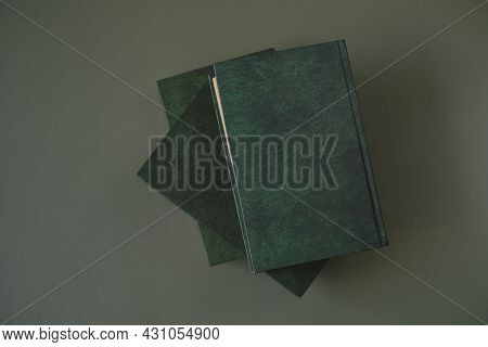 Reading Of Books.business Literature And Trainings. Knowledge And Education. Books Stack With Green