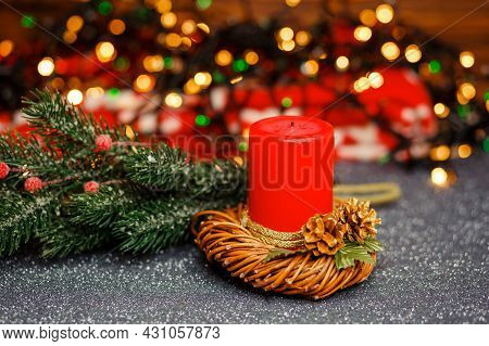 Vintage Christmas Decor. Colorful Bokeh. Golden Xmas. Burning Candles Over Old Wooden Table With Bok