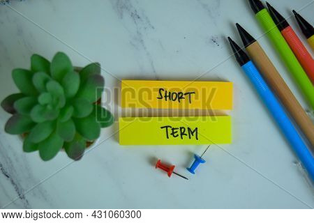 Short Term Write On Sticky Notes Isolated On Wooden Table.