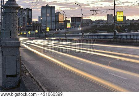 Novosibirsk, Siberia, Russia - 10.10.2019: Traces Of Headlights On The October Bridge Over The Ob Ri