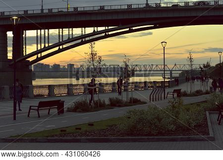 Novosibirsk, Siberia, Russia - 09.10.2019: Novosibirsk Embankment In The Evening At Sunset. Arched R