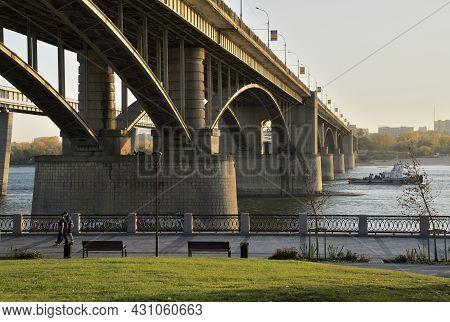 Novosibirsk, Siberia, Russia - 08.05.2019: Arched Road Bridge Over The Ob River In The Big City - Th