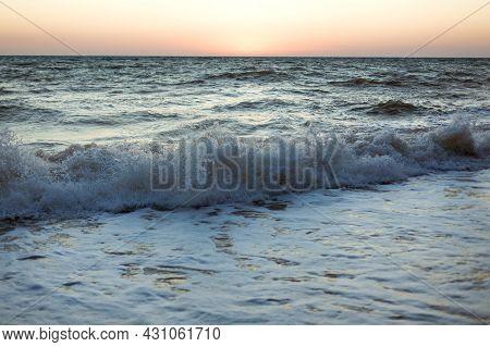 Evening Dark Sea Blue Waves Sunset Sandy Beach. Soft Wave Of Ocean Foam. Natural Background. Wallpap
