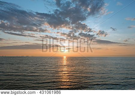 Aerial from a beautiful sunset at the North Sea with freighters at the horizon