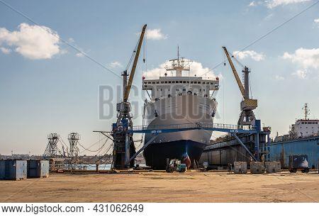 Large Ship In Dry Dock Of Shipyard