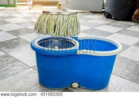 Close-up Of Mops And A Bucket Of Products For Cleaning Floors.