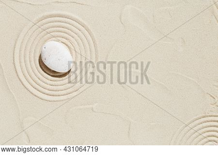 Zen Garden Meditation Sandy Background With Copy Space. White Stone And Lines On Sand For Relaxation