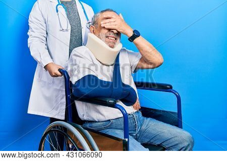 Handsome senior man with beard sitting on wheelchair with neck collar smiling and laughing with hand on face covering eyes for surprise. blind concept.