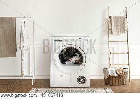 Washing machine in a minimal laundry room interior design
