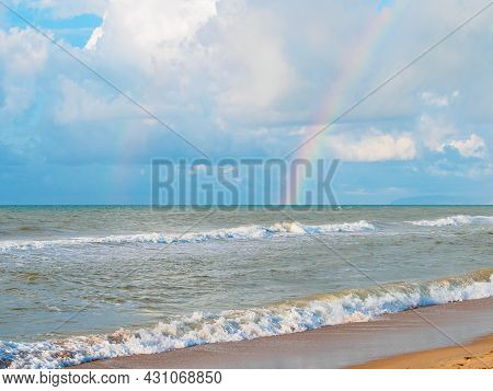 Lovely Double Rainbow In The Sky Over The Sea And Waves