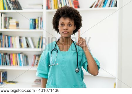 Afro American Female Nurse Gesturing Stop And Attention At Hospital