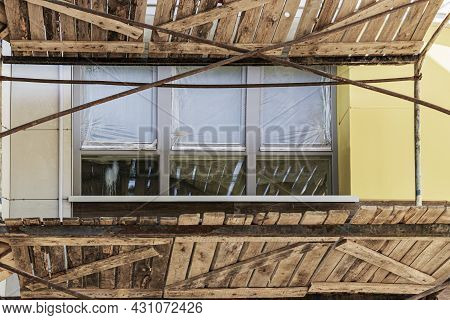 Scaffolding And Scaffolding With Wooden Decks, During The Reconstruction Of The Building. Performing