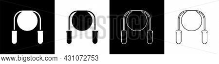 Set Jump Rope Icon Isolated On Black And White Background. Skipping Rope. Sport Equipment. Vector