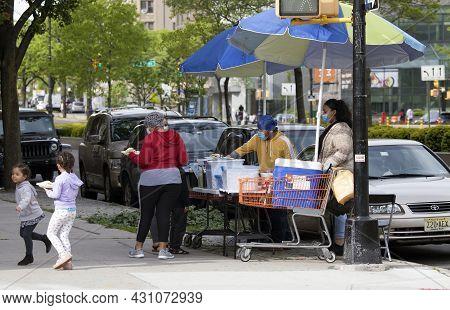 Bronx, New York/usa - May 18, 2020: Food Vendor Preparing Food For Sale Outdoors.
