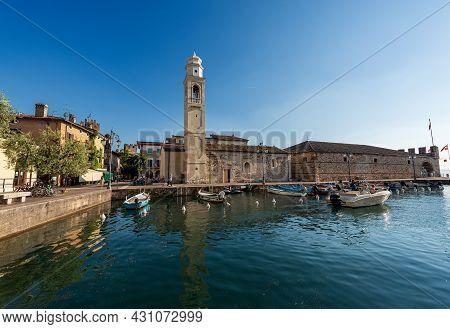 Port Of The Small Village Of Lazise, Tourist Resort On The Coast Of Lake Garda (lago Di Garda). Anci