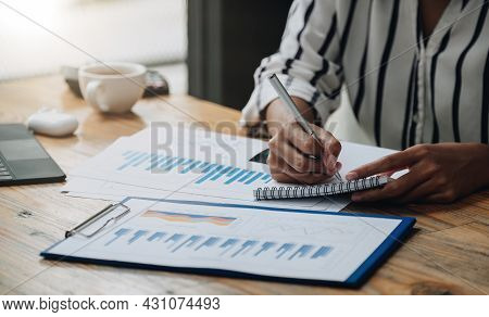 Female Accounting Or Bookkeeper Providing Accounting Service For Small Businesses, Holding Pen To Ma