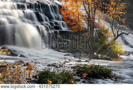 Scenic Bond falls in Michigan upper peninsula during autumn time