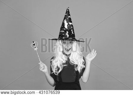 Happy Girl Wear Witch Hat Holding Magic Wand To Create Enchantment On Halloween, Happy Halloween Won