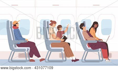 Airplane Passengers Sitting On Chairs In Plane Cabin During Air Flight. Side View Of People On Seats
