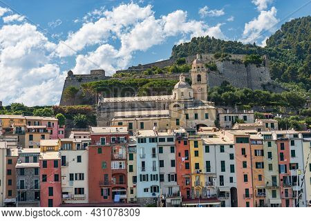 Cityscape Of Porto Venere Or Portovenere Village, View From The Sea With The Colorful Houses-tower,