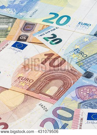 Bunch Of Euro Banknote. Many Euro Bills Lie On Top Of Each Other. Pile Of Money Of The European Unio