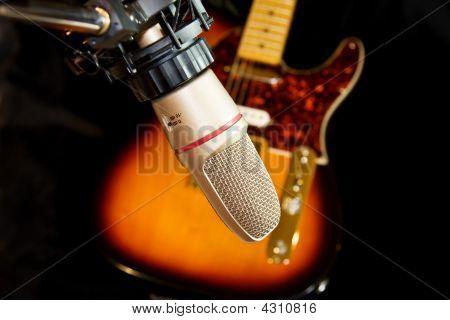 Studio Recording Microphone Over Electric Guitar