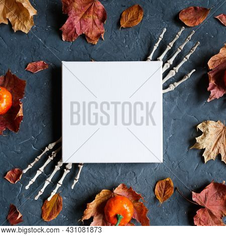 Halloween Canvas Mockup. Blank Canvas Frame And Halloween Decoration On Dark Background. Top View.