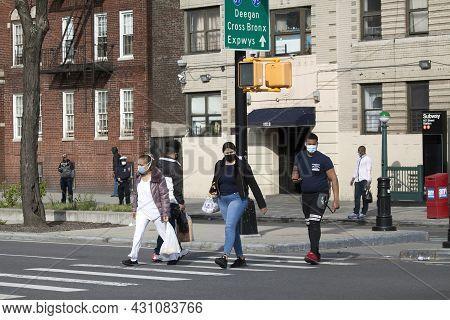 Bronx, New York/usa - May 18, 2020: People Wearing Masks Prepare To Cross Street.
