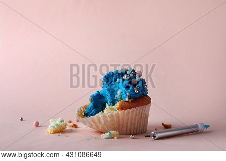 Failed Cupcake And Candle On Pink Background. Troubles Happen