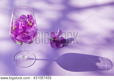 Summer Creative Composition Made Of  Glass With Hibiscus Flower Water On Pastel Background With Sunl