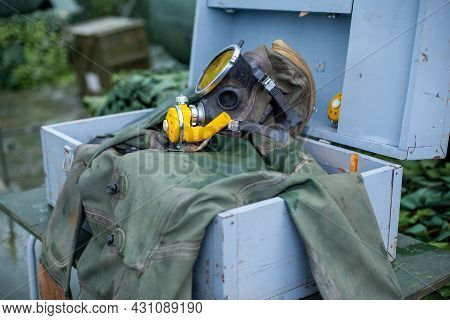 Old Scuba Diving. Divers Equipment. A Mask, Fins And A Green Diving Suit. Clothing For Diving Under
