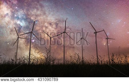 Galactic Center Of The Milky Way With Windmills In Silhouette Over A Foggy Field. 3d Rendering
