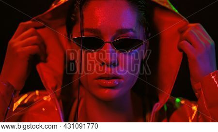 Holding A Hood Or Cape And Sunglasses Sensual Girl In Street Style Fashion Night Portrait Of Neon Li
