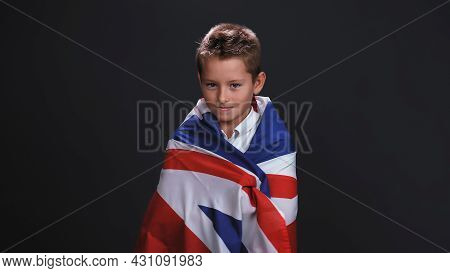 Little Boy Patriot Standing Side Turned Wrapped In A Uk Or British Flag Celebrates Independence Day