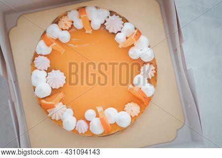 Fresh Baked Sweets And Delicious Orange Sponge Cake Decoration With Orange Jelly Sauce And Orange Pu