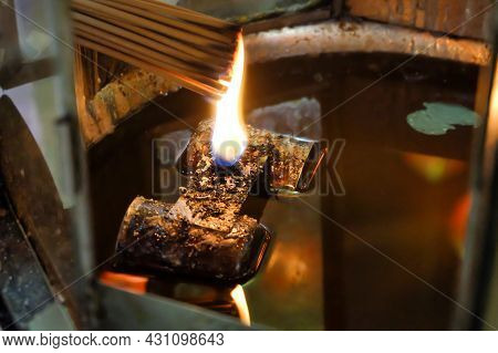 People Were Lit Incense Stick At  Lamp In A Shrine To Pray For The Gods. Asian Beliefs Religious Cer