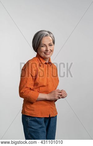 Middle Aged Grey Haired Pretty Woman Smile Gentle Looking At Camera With Touching Finger Tips Wearin