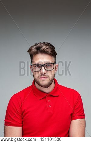 Portrait Of Young Man In Spectacles Looking At Camera. Guy With Glasses. Confident Businessman Weari