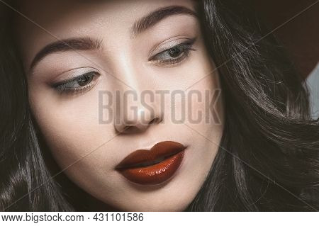 Beautiful Young Woman Face With Beautiful Long Dark Hair And Make Up. Young Female Model With Profes
