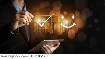 Businessman Holding Digital With A Checked Box On Excellent Smiley Face Rating For A Satisfaction Su