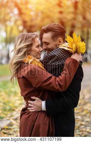 Half-length Portrait Of A Kissing Young Couple. Husband And A Wife Hugged Smile Looking At Each Othe