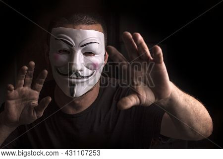Ukraine, Odessa, Summer 2021. Anonymous With Guy Fawkes Mask With Raised Hands.
