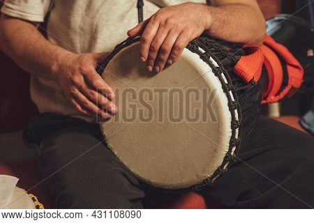 Hands Of A Drummer Playing The Ethnic Percussion Musical Instrument Djembe.