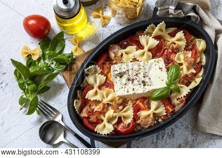Baked Feta Pasta, Or Tiktok Pasta On Gray Background. Oven Baked Feta Pasta Made Of Tomatoes, Feta C