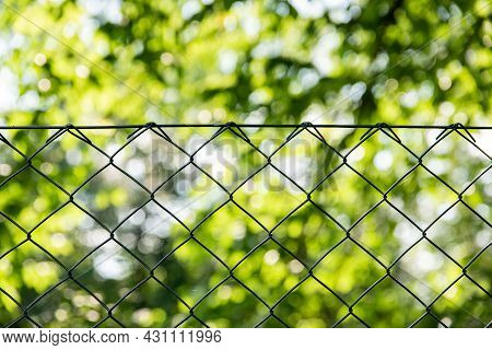 Close Up Of Green Garden Fencing. Green Plastic Coated Wire Fencing. Pvc Coated Wire Mesh.