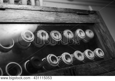Vintage Electrical Fuses Mounted On A  Dark Panel In Wooden Case,  Black And White Photo