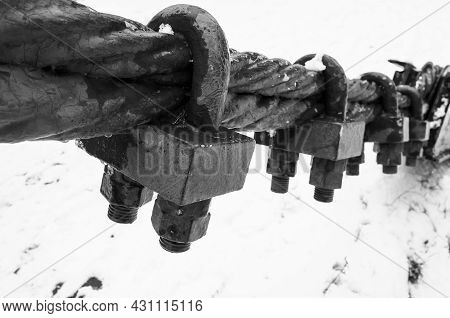 Black Steel Rope With End Fixing Locks, Black And White Photo With Selective Focus